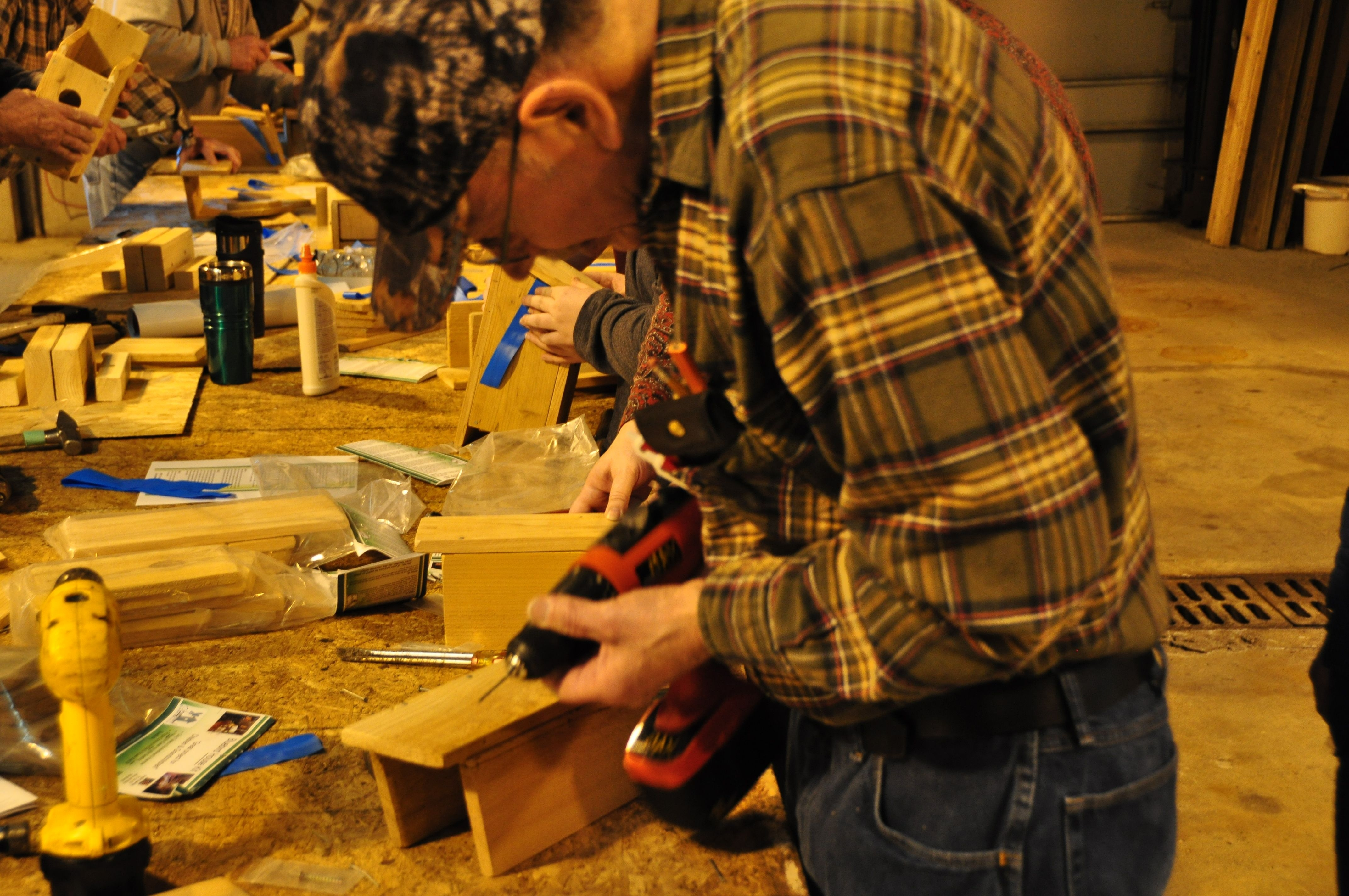 Volunteer building a birdhouse